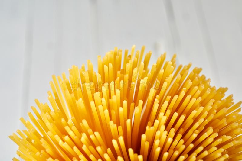Golden spaghetti bundle close up with copy space stock images