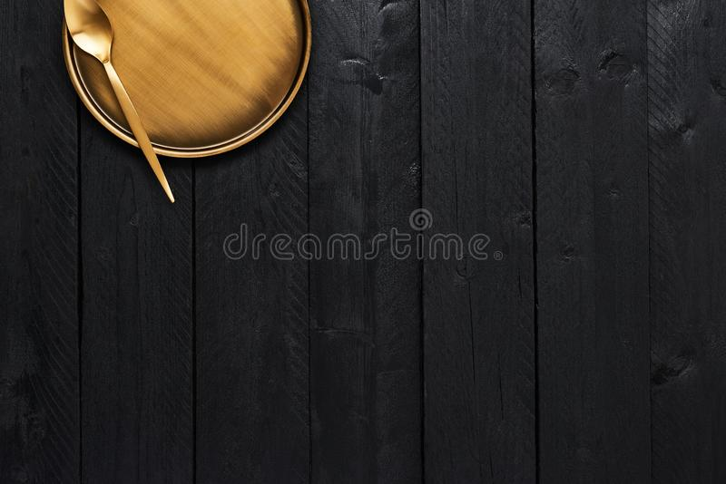 Golden spoon and serving plate royalty free stock image