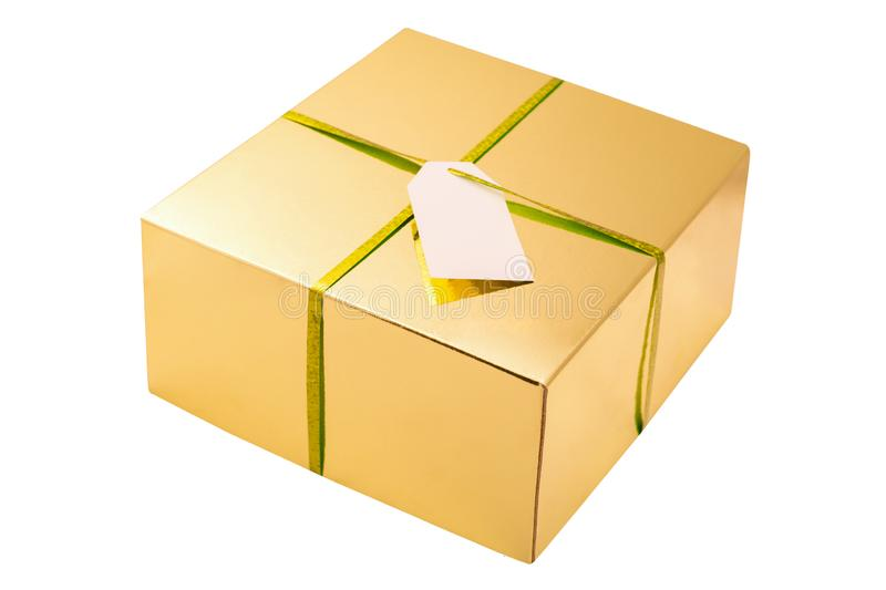 Golden square box with bibbon and blank white card isolated on white background. Golden gift box royalty free stock image