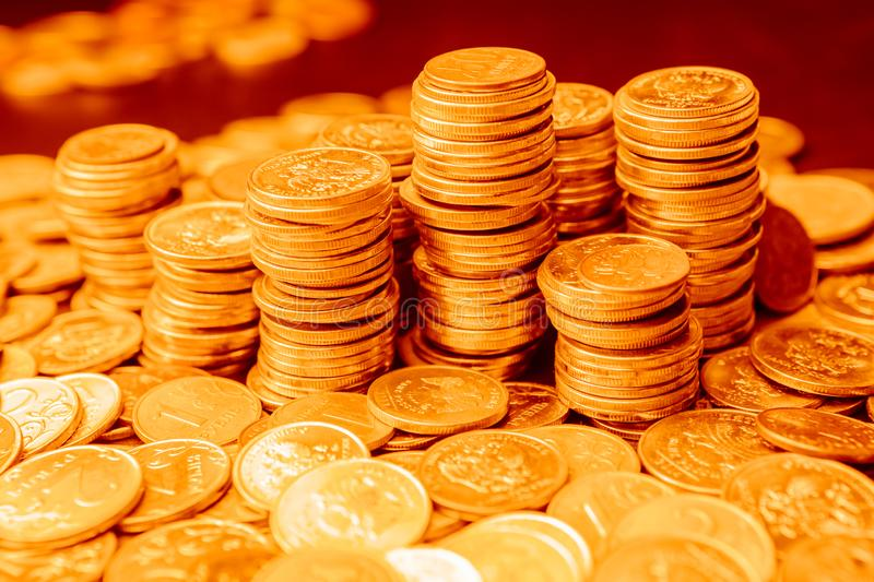 Golden Stacks of different rubles coins royalty free stock photo