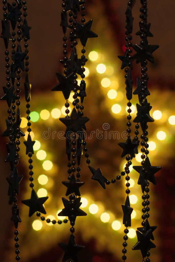 Golden star background. Small stars on a big glowing star the modern bokeh background royalty free stock photography