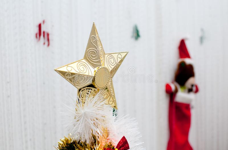 Golden star decoration for Christmas tree royalty free stock photography