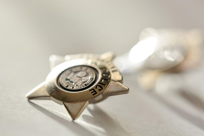 Golden star police badge. Shallow dof royalty free stock image