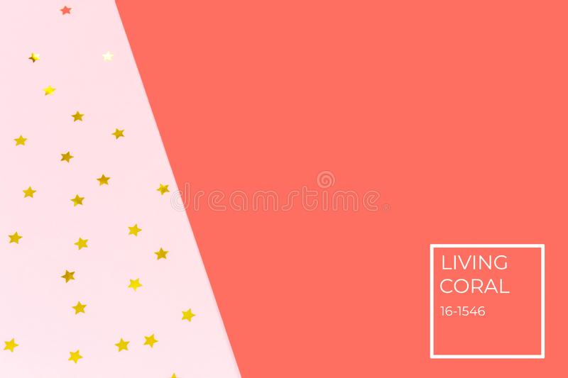 Golden star sprinkles on double pink and blue. Festive holiday background. Celebration concept . Living coral theme - color of the stock photos