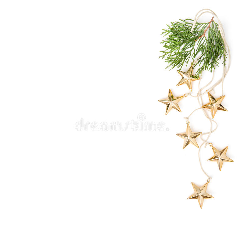 Golden stars evergreen branches Christmas ornaments minimal stock photos