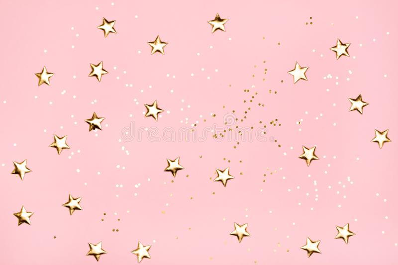 Golden stars glitter on pink background. stock photos