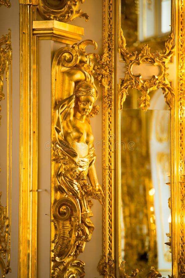 Golden statue in ballroom of roccoco palace Catherine Palace,  located in the town of Tsarskoye Selo or Pushkin St. Petersburg royalty free stock photos