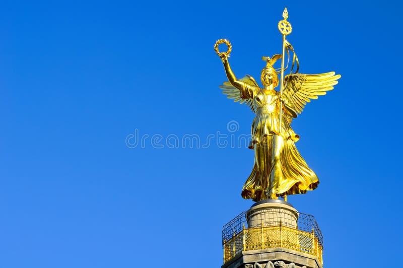 Golden statue berlin royalty free stock photo