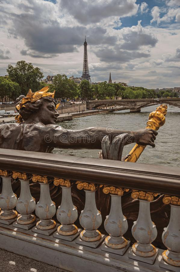 Golden statue on bridge at Seine River and Eiffel Tower in Paris. Golden statue adorning the Alexandre III bridge over the Seine River and Eiffel Tower in Paris stock images