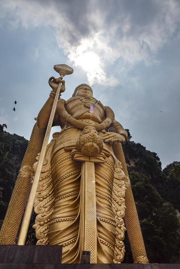 Batu Cave, Kuala Lumpur, Malaysia. Golden statue of Lord Muragan outside the Batu Caves, Hindu shrine near Kuala Lumpur Malaysia royalty free stock photography