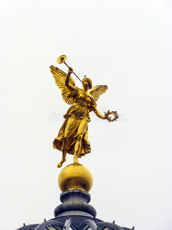 Golden statue of Muse on top of Academy of Arts in Dresden, Germany.  royalty free stock image