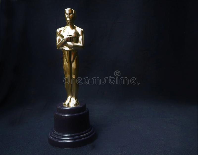 The golden statue of Oscar on a black background stock photos