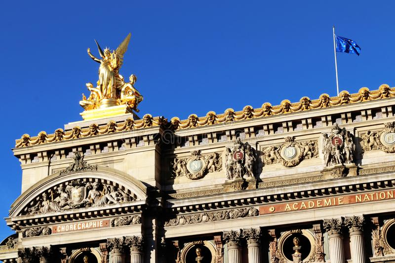 Grand Opera Paris Garnier golden statue on the rooftop and facade front view france royalty free stock images