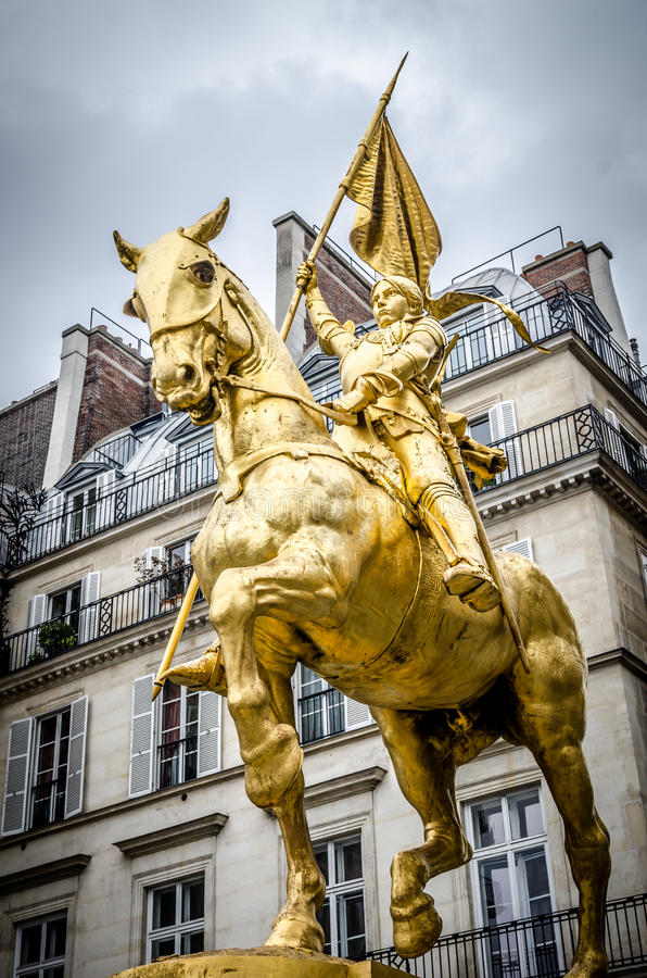 The golden statue of Saint Joan of Arc stock image