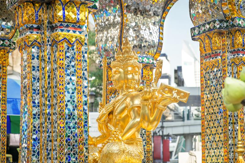 Golden statue of Thao Maha Phrom at the Erawan Shrine. royalty free stock images
