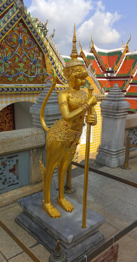 Golden statue in the Wat Phra Kaew, Temple of the Emerald Buddha in Thailand stock photo