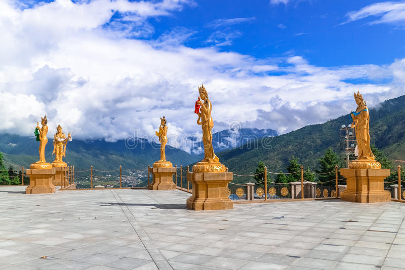 Golden statues of Buddhist female gods at Buddha Dordenma temple, Thimphu, Bhutan. South Asia royalty free stock photography