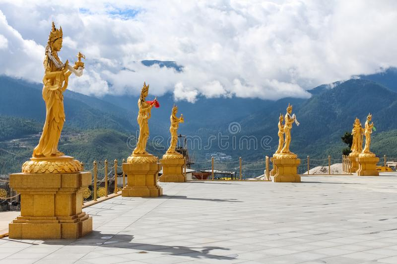 Golden statues of Buddhist Goddesses at top hill in Kuensel Phodrang Nature Park, Thimphu, Bhutan. Golden statues of Buddhist female gods at Buddha Dordenma royalty free stock photography
