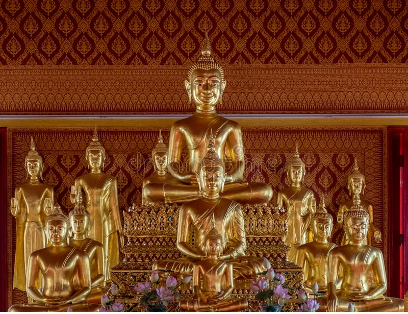 Golden statues at Buddhist temple in Bangkok royalty free stock photos