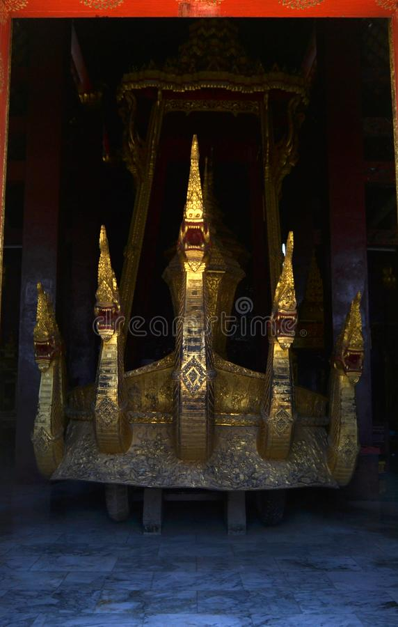 Golden Statues Murals and Carving in the Buddhist Temples of Luang Prabang Laos. Beautiful golden artwork, murals, statues and carvings in and around the royalty free stock photo