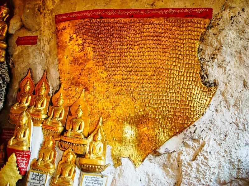 golden statues in a temple in burma stock images