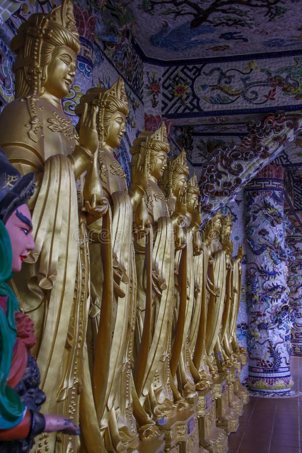 Golden statues in in Vietnam in Da Lat city Linh Phuoc Pagoda stock photos