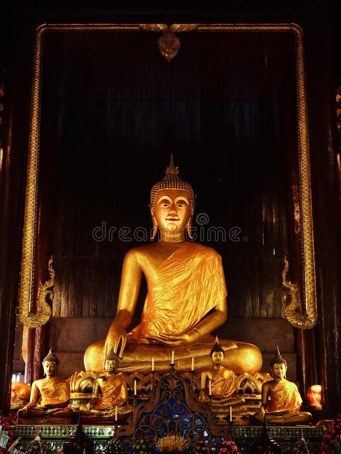 A golden stature of Buddha. A golden stature of Buddha in Chiangmai, Thailand royalty free stock photos
