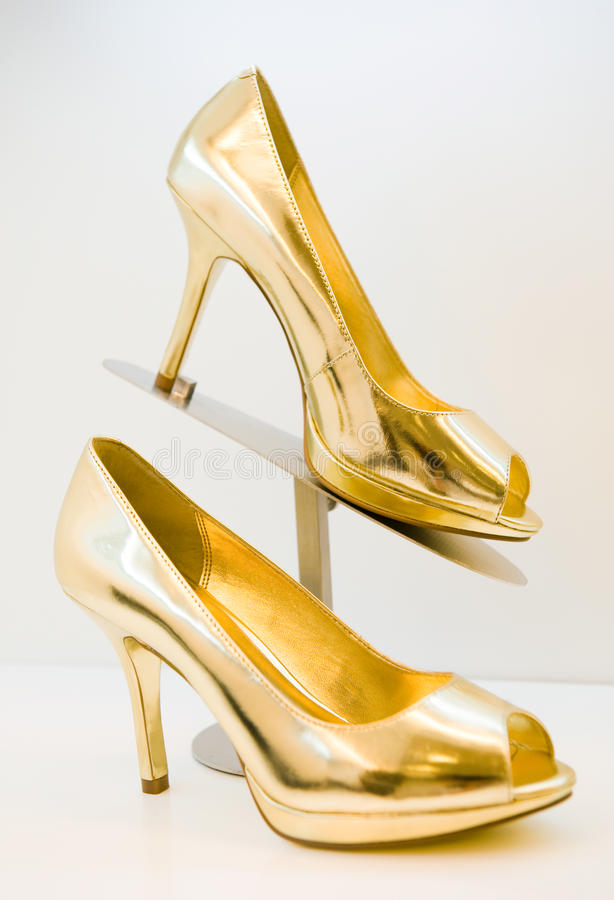 Golden stiletto high heels royalty free stock images