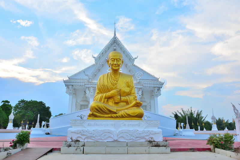 Golden stone stature of a Buddha. Golden stone stature of a Buddha temple in Thailand royalty free stock photo