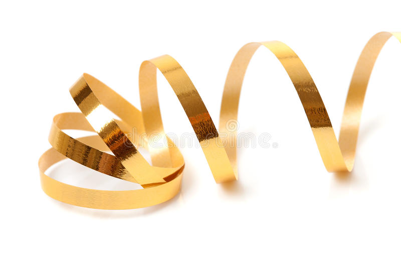 Golden streamer. Over white background royalty free stock photo