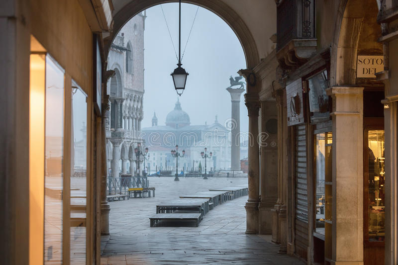 Golden streets of Venice. View to San Marco plaza from the arch in misty morning stock images