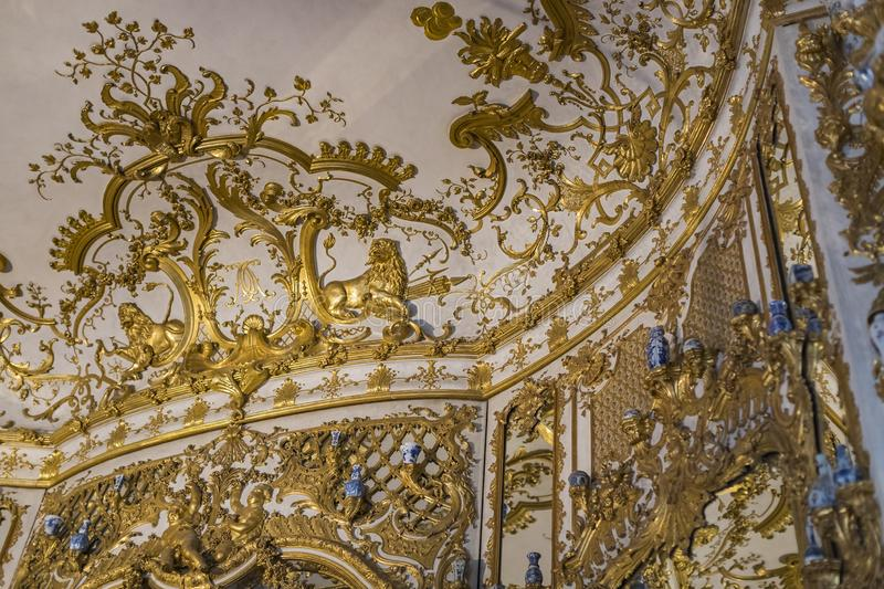 Golden stucco decoration of the interior of the museum residence Munich Residenz, the Bavarian kings. MUNICH, GERMANY - NOVEMBER 27, 2018 :Golden stucco stock photos