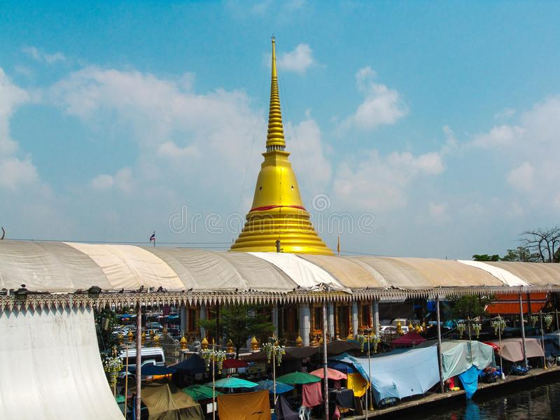 The Golden stupa in Wat Bangplee Yainai, Samut Prakan, Thailand. With blue sky background royalty free stock images