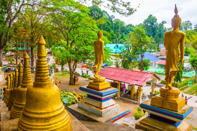 Golden stupas in Tiger Cave Temple, Wat Tham Suea, Krabi, Thailand royalty free stock images