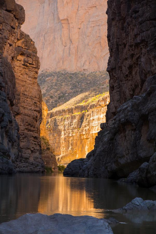 Golden sun and dark shadow, Santa Elena Canyon, Texas. Dramatic , afternoon view of Santa Elena Canyon in Big Band National Park. The low sunlight reaches the stock photos