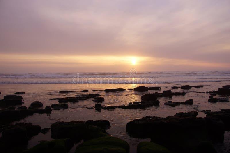 Golden sun setting on the Pacific Ocean stock photo