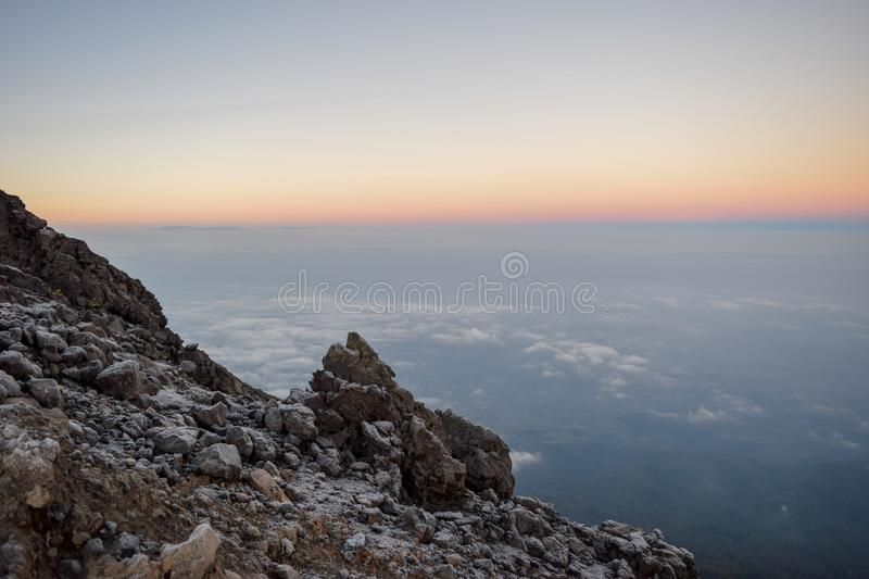 Sunset above the clouds at Mount Meru, Arusha National Park, Tanzania. A golden sunrise at Mount Meru, Arusha National Park, Tanzania stock images