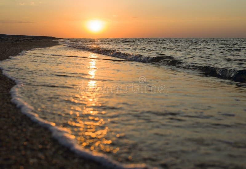 Golden sunrise over the beach stock images