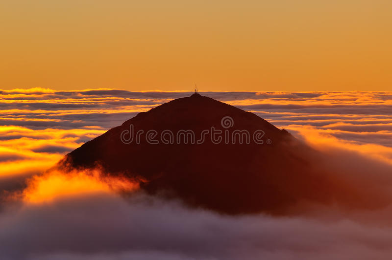 Golden sunrise over the ocean of clouds