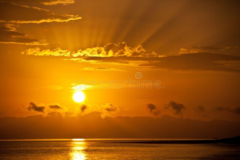 Golden sunrise over the sea stock image