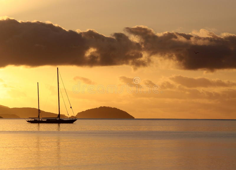 Golden sunrise over the tropical islands stock photos