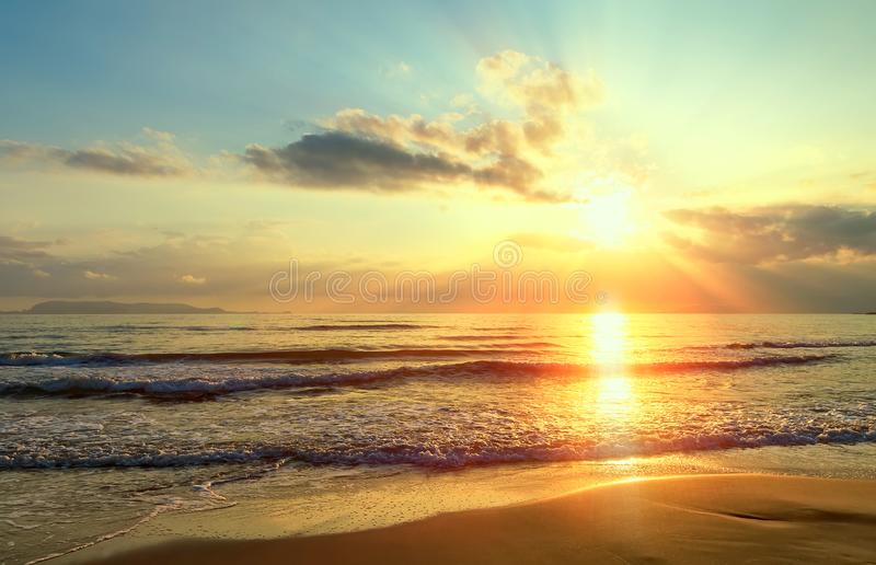 Golden sunrise sunset over the sea ocean waves. Rich in dark clouds, rays of light. Golden sunrise sunset over the sea ocean waves stock image