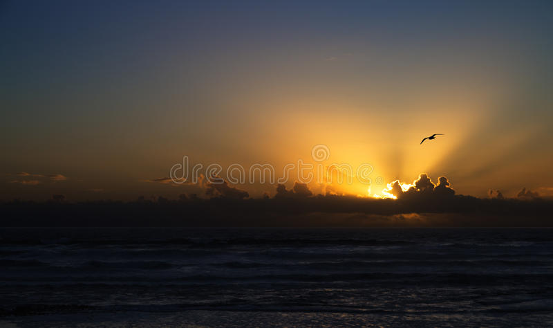 Sunset over the ocean royalty free stock image