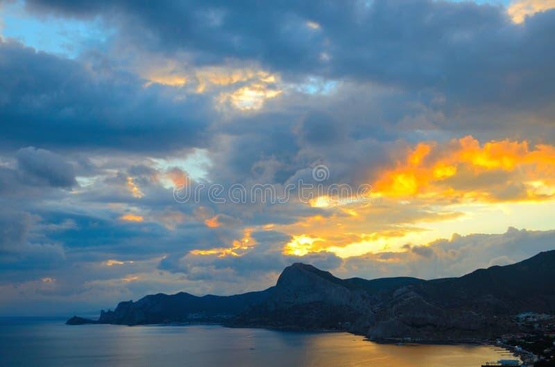 Golden sunset on the Black sea coast in Crimea, Sudak stock photography