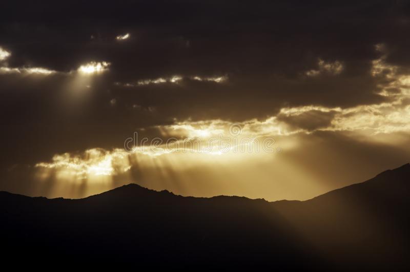 Golden Sunset with God Rays - Kabul, Afghanistan - High Contrast. Golden sunset as seen from near NATO HQ in Kabul, Afghanistan with a high contrast and dramatic stock images