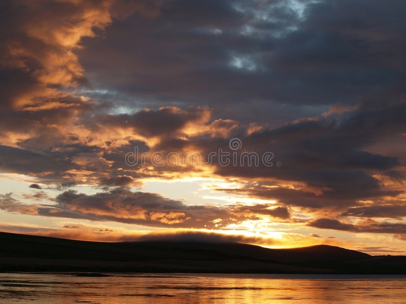 Golden sunset over lake royalty free stock image