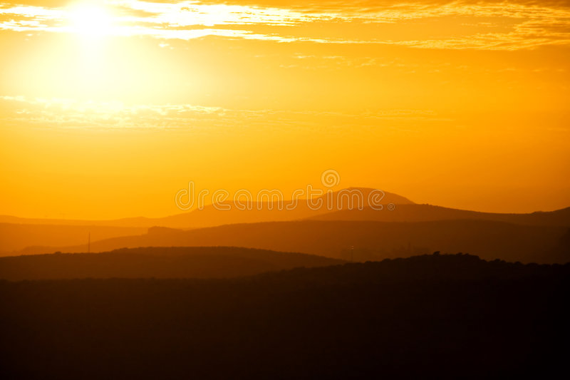 Golden Sunset over Mountains. Golden sunset over Gran Canarian mountain silhouettes stock photography