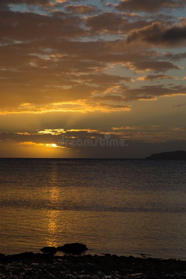 Golden sunset over ocean . Sky Fiji stock photography
