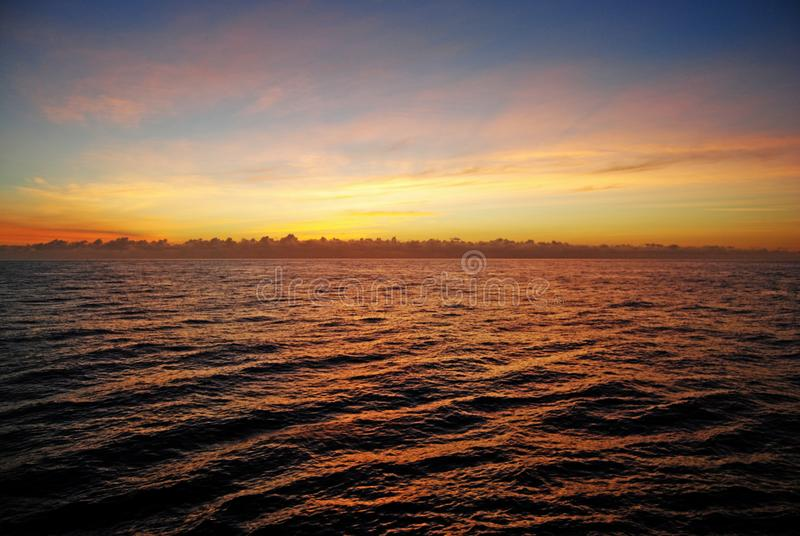 Golden Sunset Over The Ocean royalty free stock images