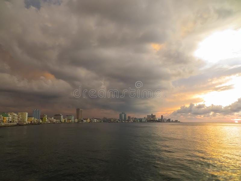 Golden sunset over the sea with cloudy sky royalty free stock photography